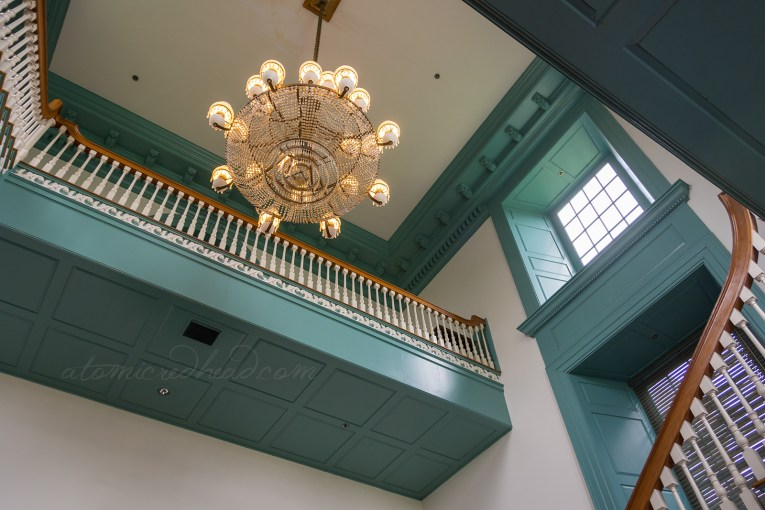 Inside Independence Hall, a large chandelier hangs from the ceiling.