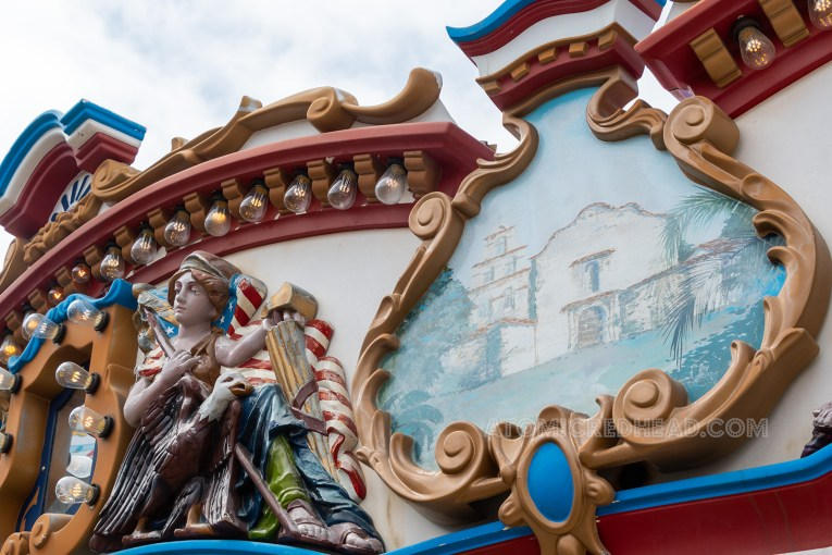 A painting of the San Diego Mission is atop the edge of the carousel.