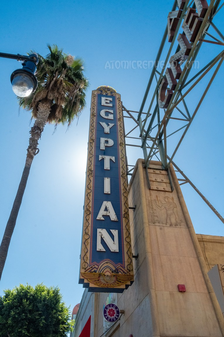 """The long neon sign for the Egyptian, which reads """"Egyptian"""" in white letters."""