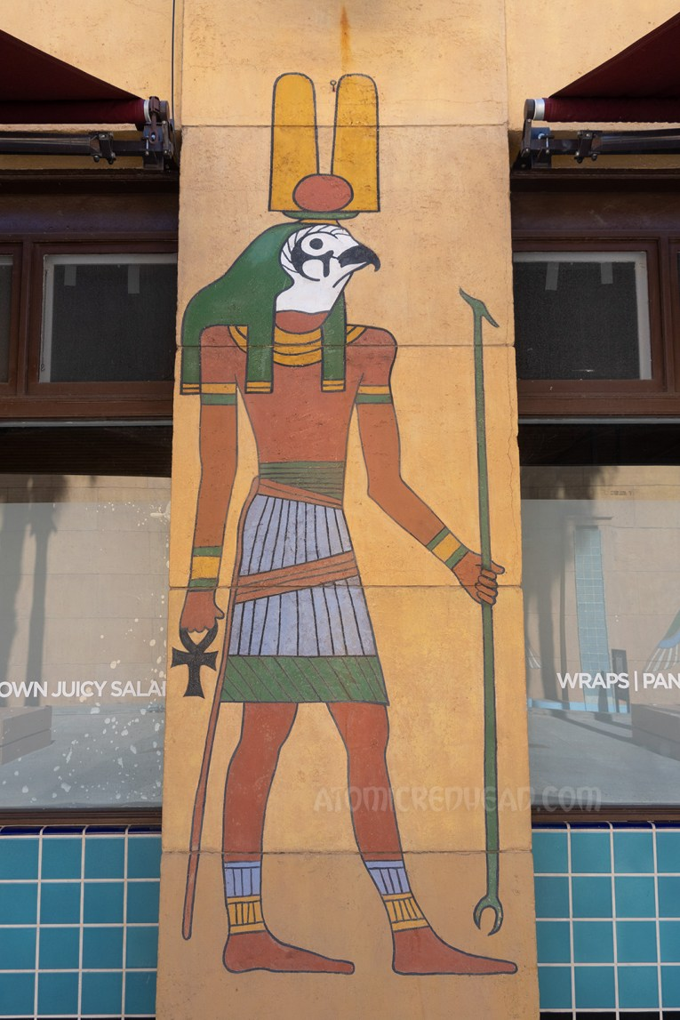 A painted mural of the Egyptian god Horus, which is a man's body with the head of a hawk.