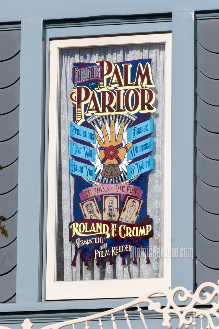 "A window with a gold hand with ribbons wrapped around it, and a rose in the center. Text around it reads ""Fargo's Palm Parlor Predictions that will Haunt You Bazarr, Whimsical & Weird Designs to Die For Roland F. Crump Assistant to the Palm Reader"""