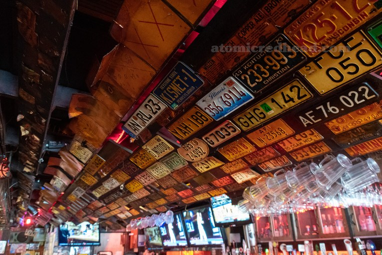 License plates hang on the wall above the bar.