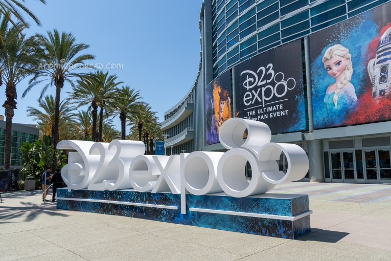 "Outside of the Anaheim Convention Center, a massive white statue spells out ""D23 expo"""