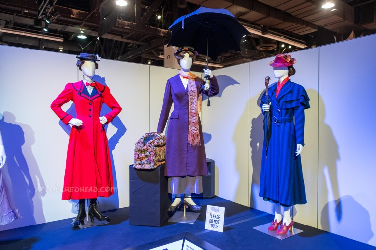 The various Mary Poppins costumes from the original 60s film, the sequel, and the Broadway production. The original features a dark overcoat and a white blouse with red bowtie, pink scarf, and carpet bag. The sequel features a bright blue overcoat and red hat and red shoes, the Broadway features a red overcoat, and black hat.