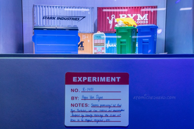 "An Ant-Man experiment, tiny dumpsters, and trash cans, including one found by the attraction, it's a small world, with a sticker reading ""Experiment No.: R-1401 By: Hope Van Dyne Notes: Seems promising! W/Red Pym Particles we can reduce our environmental footprint by literally reducing the size of items to be shipped, recycled, etc."""