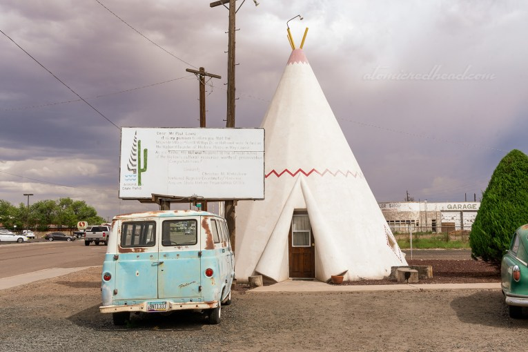 "One of the ""cabins"" a concrete tipi, painted white with a red zig-zag across the middle."