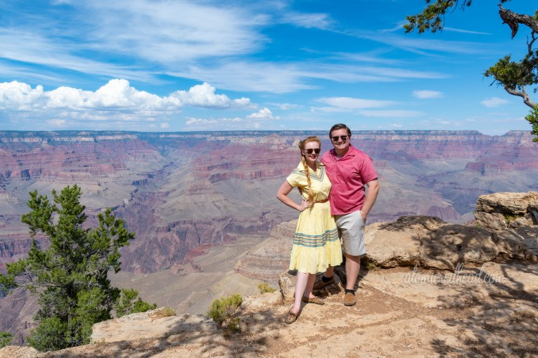 Patrick and I in front of the Grand Canyon, Patrick wears a pale red button down shirt and tan shorts.