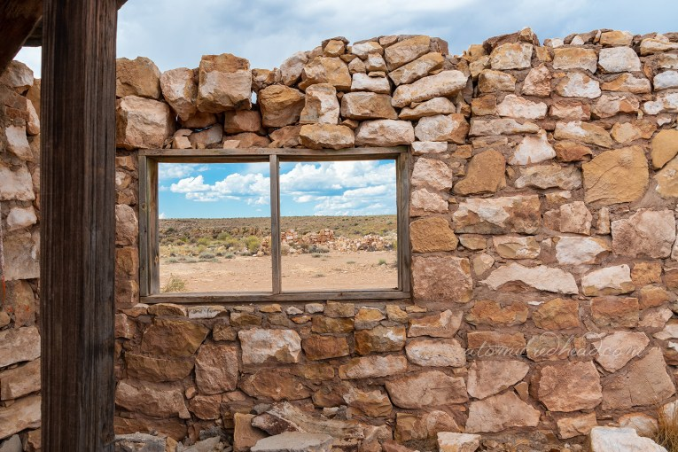 The landscape as seen through one of the broken out windows of one of the abandoned stone structures.