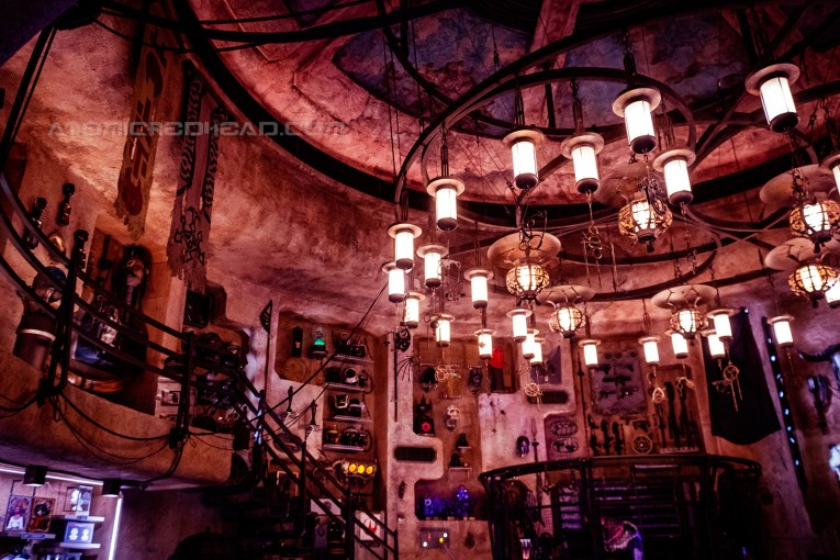 Inside the antiquities shop. Various artifacts hang on the wall, a massive chandelier hangs from the ceiling.