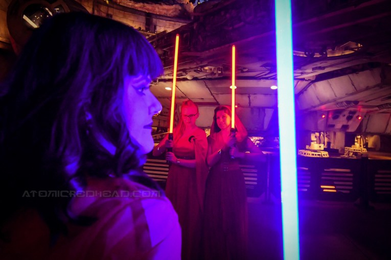 Brittany with her blue light saber holds it near the camera, while Solanah and I with our red lightsabers stand, almost ready to strike in the background.