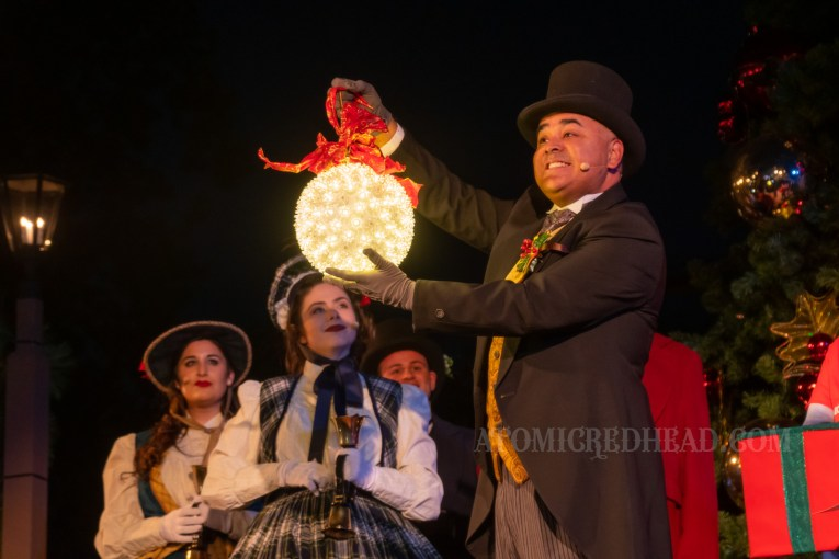 "The mayor of ""Calico"" the area also known as Ghost Town, wears a black suit and top hat and holds a large lighted Christmas ornament."