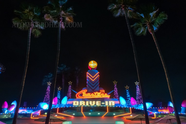 Coasters Drive In features large blue and pink lights and pink and blue Christmas trees.