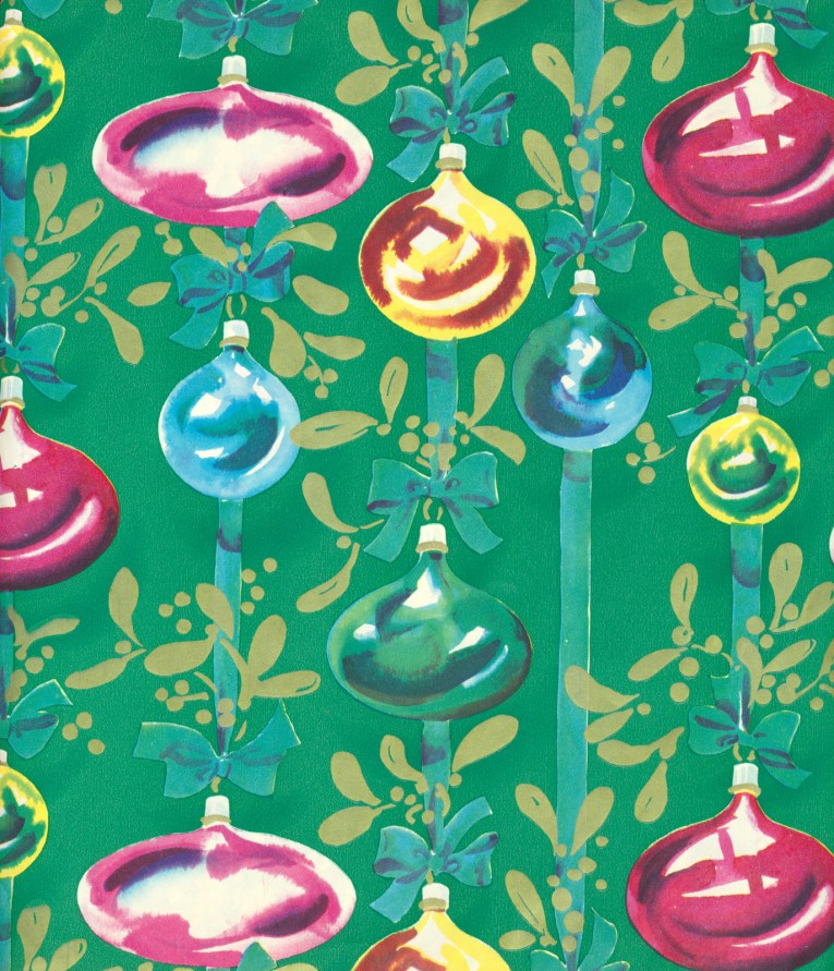 Blue, pink, gold, and green ornaments hang on blue ribbon against a green background.