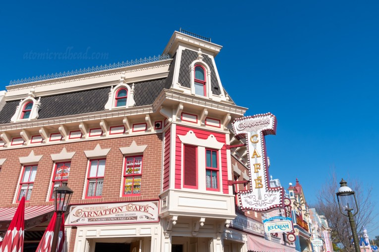 The Carnation Cafe, a red Victorian style building with white trim.