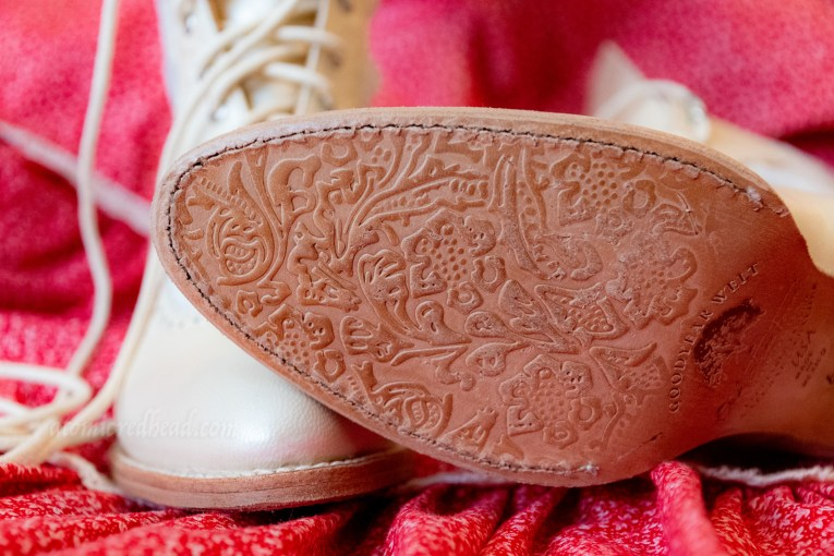 Close-up of the sole of my shoes, which feature an embossed floral design.
