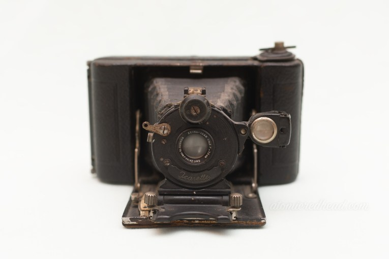 Zeiss Icarette. A small black camera with a bellows that comes out from the middle.