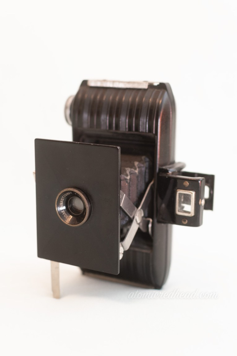 Kodak Bantam. A small bellows style camera with ribbing on the side.