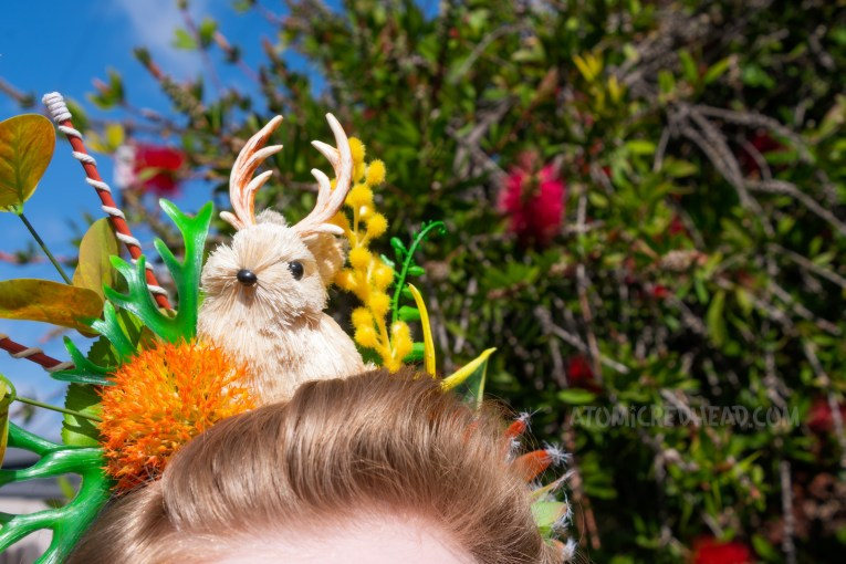 Close-up of my crown, which features green, orange, and yellow succulents, and a small cream colored jackalope.