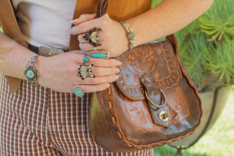 Close-up of my purse and my various turquoise rings.