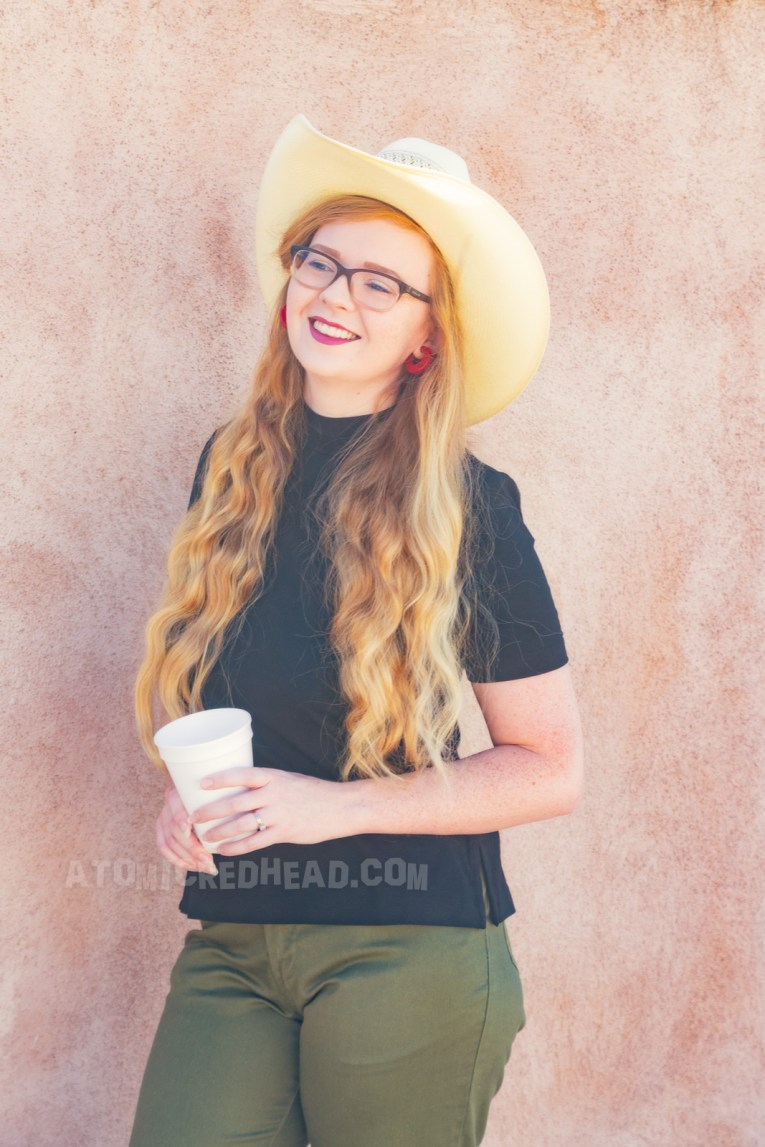 Myself wearing a straw cowboy hat, black mock turtle neck, olive capris and white pointed flats.