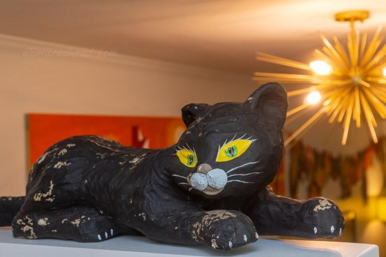 A paper machine black cat.