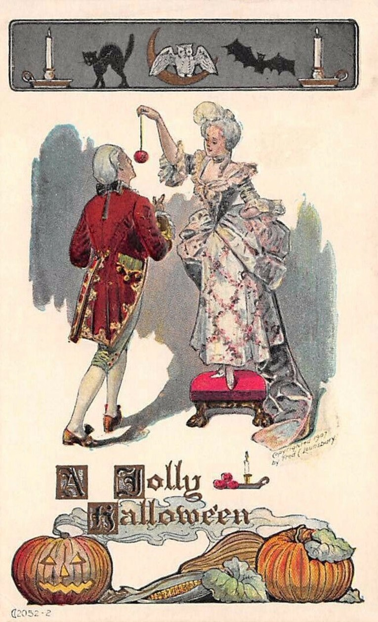 "A couple in 1770s attire, the woman holds an apple on a string while a man attempts to bite into it. Text reads ""A Jolly Halloween."""