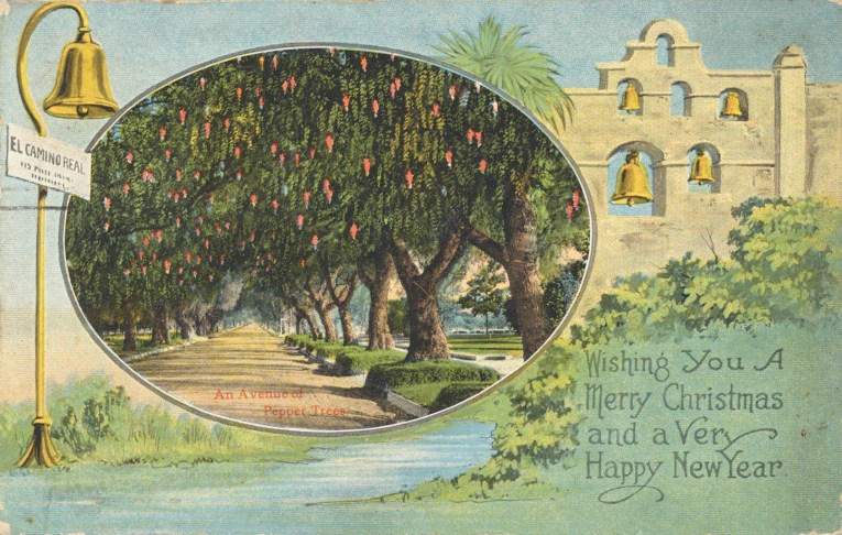 "A largely blue and green postcard features an illustration of a mission, to the left a circle features an image of pepper trees, and outside the circle is an El Camino Real bell. Text in the lower right reads ""Wishing You a Merry Christmas and a Very Happy New Year"""