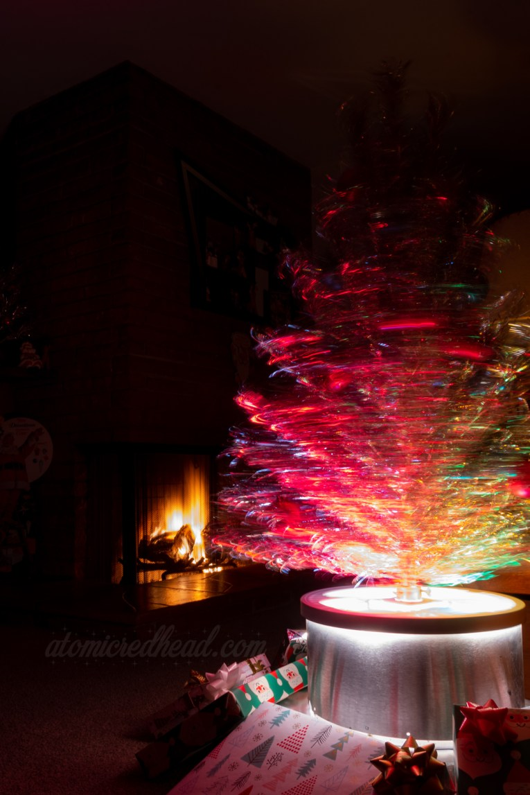 A long exposure of our silver tree spinning in its rotating stand and color wheel-all-in-one.