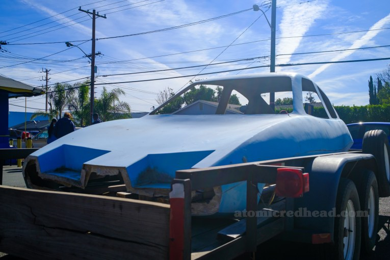 The front of the blue Dale body that sits on top of a trailer.