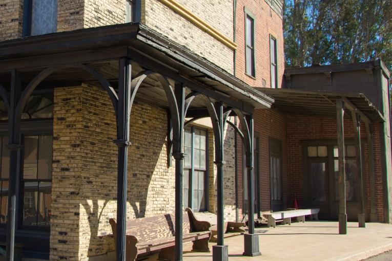 The corner of a pale brick building.