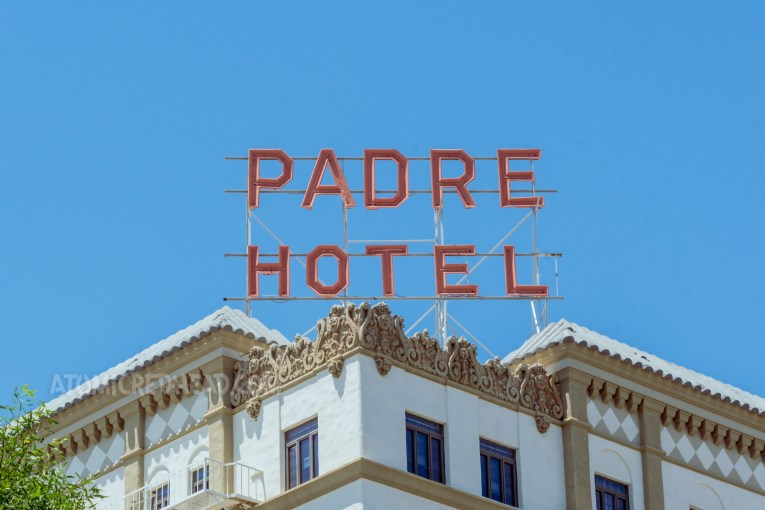 """Large red letters sit atop the roof reading """"Padre Hotel"""""""