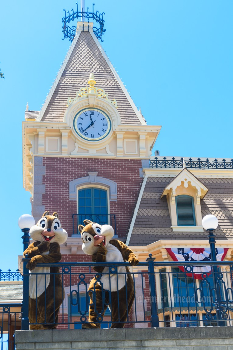 Chip and Dale wave from the Main Street Train station.