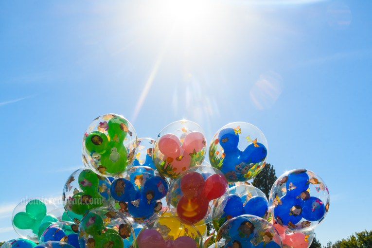 Colorful Mickey shaped balloons in the sun.