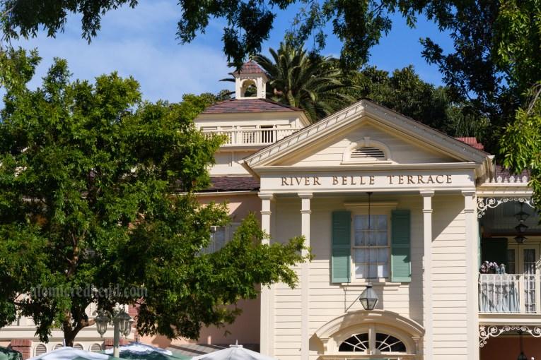 The elegant cream building of River Belle Terrace, with sea foam shutters.