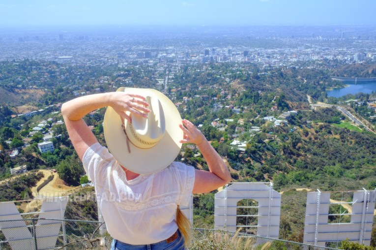Myself looking out toward the city. The letters of the Hollywood sign below me.