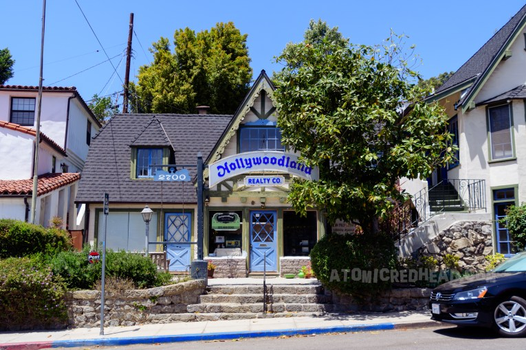 A small green Tudor style building that is the Hollywoodland Reality office.