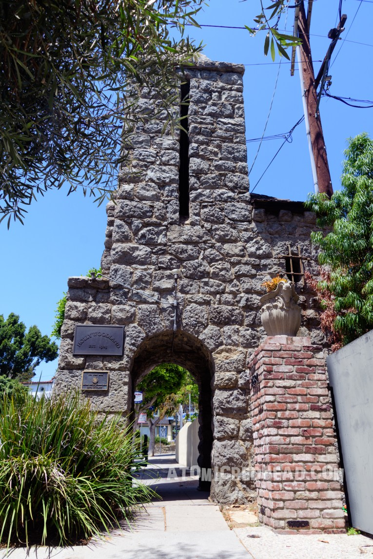One of the stone gateways to Hollywoodland. Made up of grey stones, an arched walkway with a tower above.