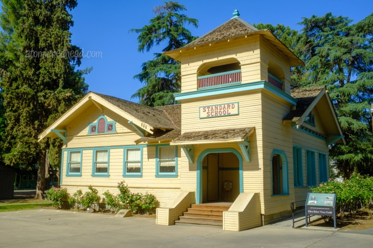 The Standard School, named for the Standard Oil Company, painted yellow with blue trim.