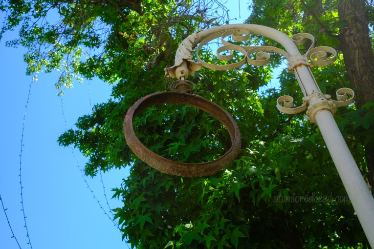 The remains of a large clock that was made to resemble a pocket watch to advertise a watch maker shop.