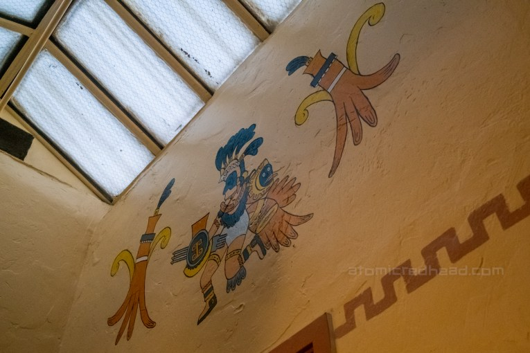 Mural of an ancient god painted on the wall.