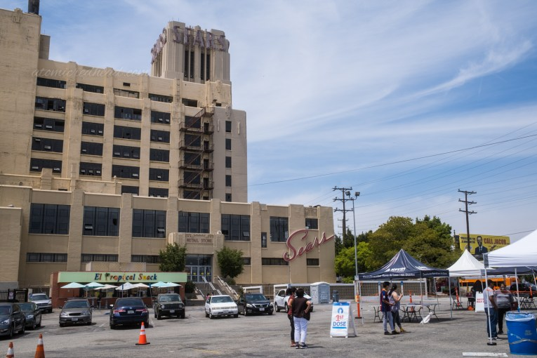 A COVID-19 testing and vaccination site set up in the parking lot of the Sears.