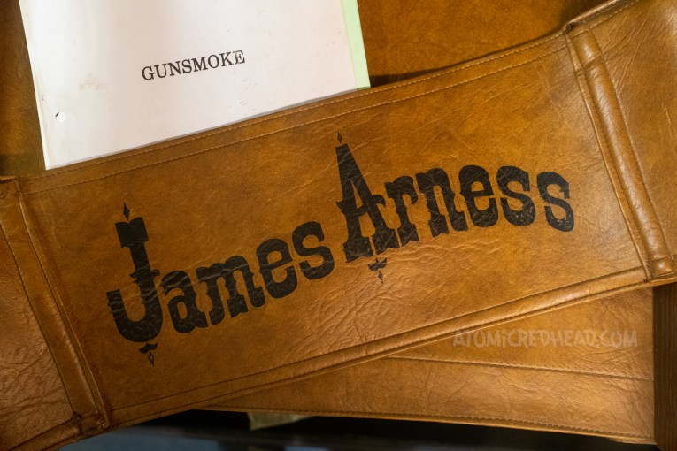 The leather back from James Arness' chair from the set of Gunsmoke. His name is painted in an old west style font.
