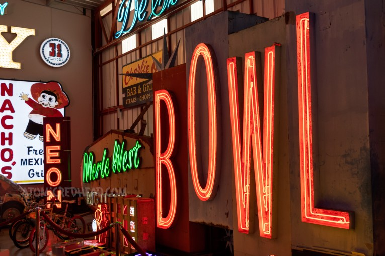 """A massive sign reads """"BOWL"""" in red neon."""