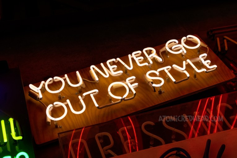 """White neon that reads """"You Never Go Out of Style"""""""