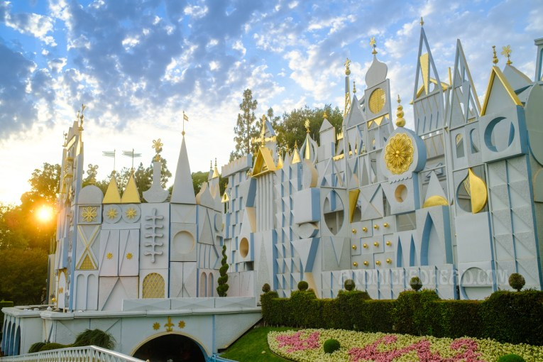 The abstract facade of 'it's a small world' with gold leaf detaisl.