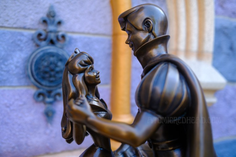Close-up of a small statue of Princess Aurora and Prince Phillip.