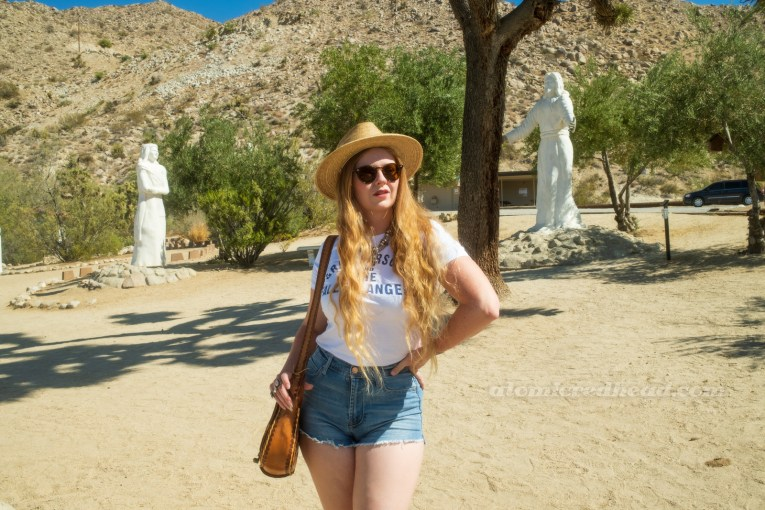 Myself, wearing a straw hat, a white shirt reading 'Gram Parsons and the Fallen Angels' in blue text, blue jean shorts,
