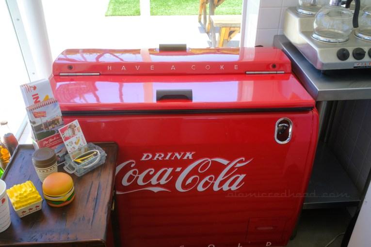 A vintage red Coca-Cola cooler.