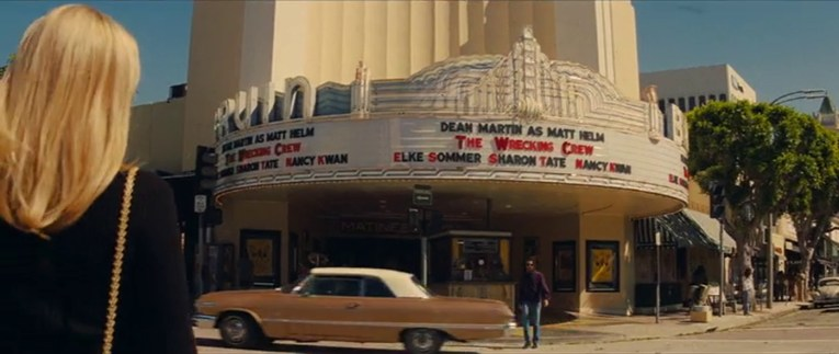 """The Bruin as seen in Once Upon a Time...In Hollywood, with neon above its marquee displaying """"The Wrecking Crew"""""""