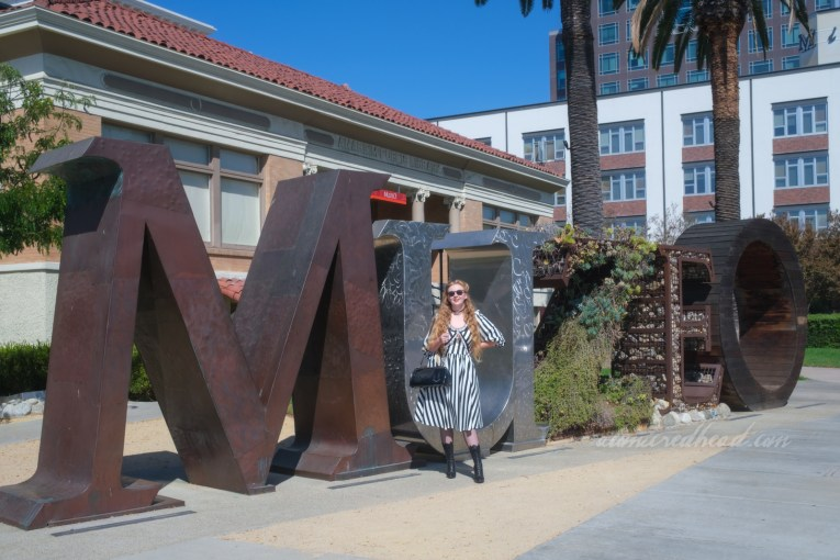 """Myself standing in front of the Muzeo sign, which reads """"Muzeo"""" in large letters."""
